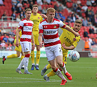 Doncaster Rovers' Brad Halliday shields the ball from Fleetwood Town's Conor McAleny<br /> <br /> Photographer David Shipman/CameraSport<br /> <br /> The EFL Sky Bet League One - Doncaster Rovers v Fleetwood Town - Saturday 17th August 2019  - Keepmoat Stadium - Doncaster<br /> <br /> World Copyright © 2019 CameraSport. All rights reserved. 43 Linden Ave. Countesthorpe. Leicester. England. LE8 5PG - Tel: +44 (0) 116 277 4147 - admin@camerasport.com - www.camerasport.com