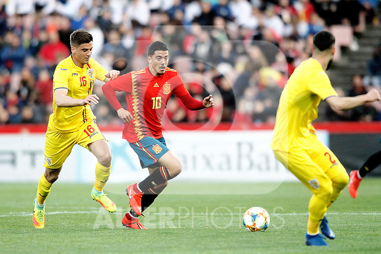 Romania's Nedelcu Dracos and Spain's Pablo Fornals   during the International Friendly match on 21th March, 2019 in Granada, Spain. (ALTERPHOTOS/Alconada)