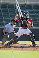 Kannapolis Intimidators catcher Brett Austin (20) on defense against the Hickory Crawdads at CMC-Northeast Stadium on May 21, 2015 in Kannapolis, North Carolina.  The Intimidators defeated the Crawdads 2-0 in game one of a double-header.  (Brian Westerholt/Four Seam Images)