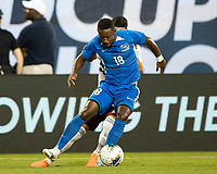 CHARLOTTE, NC - JUNE 23: Samuel Camille #18 defends against Uriel Antuna #22 during a game between Mexico and Martinique at Bank of America Stadium on June 23, 2019 in Charlotte, North Carolina.