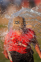 Batavia Muckdogs young fan participates in an on field water balloon competition in between innings during a game against the Aberdeen Ironbirds on July 15, 2016 at Dwyer Stadium in Batavia, New York.  Aberdeen defeated Batavia 4-2. (Mike Janes/Four Seam Images)