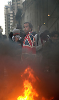 A man in a Union Jack blazer stands beside a burning effigy of a banker as thousands of protestors descended on the City of London ahead of the G20 summit of world leaders to express anger at the economic crisis, which many blame on the excesses of capitalism.