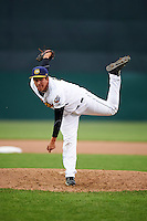 Burlington Bees relief pitcher Winston Lavendier (44) follows through on a pitch during a game against the Bowling Green Hot Rods on May 7, 2016 at Community Field in Burlington, Iowa.  Bowling Green defeated Burlington 11-1.  (Mike Janes/Four Seam Images)