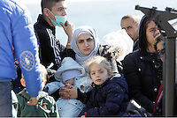 Pictured: A young mother clutrching her young baby Thursday 27 November 2014<br />