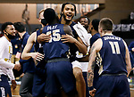 SIOUX FALLS, SD - MARCH 8: Kevin Obanor #0 of the Oral Roberts Golden Eagles is is embraced by teammate Ismael Plet #45 after Obanor tipped in the winning shot at the buzzer to defeat the South Dakota State Jackrabbits 90-88 during the Summit League Basketball Tournament at the Sanford Pentagon in Sioux Falls, SD. (Photo by Richard Carlson/Inertia)