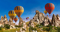 Pictures & images of hot air balloons over Uchisar Castle & the cave city houses in the rock formations & fairy chimney of Uchisar, near Goreme, Cappadocia, Nevsehir, Turkey
