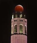 A total lunar eclipse set behind San Francisco's Coit Tower.