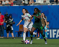 GRENOBLE, FRANCE - JUNE 22: Ngozi Okobi #13 of the Nigerian National Team dribbles as Sara Daebritz #13 of the German National Team defends during a game between Panama and Guyana at Stade des Alpes on June 22, 2019 in Grenoble, France.