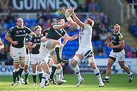 Stuart Hooper of Bath Rugby (right) and David Paice of London Irish jump for the high ball during the Aviva Premiership match between London Irish and Bath Rugby at the Madejski Stadium on Saturday 22nd September 2012 (Photo by Rob Munro)