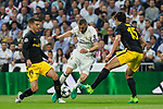 Karim Benzema of Real Madrid holds off pressure from  Lucas Hernandez, Stefan Savic  during the match of Champions League between Real Madrid and Atletico de Madrid at Santiago Bernabeu Stadium  in Madrid, Spain. May 02, 2017. (ALTERPHOTOS/Rodrigo Jimenez)