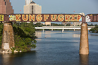 """The """"KUNG FU GRIP"""" is a famous and creative public art mural painting on the Austin Railroad Graffiti Bridge over Lady Bird Lake, Austin, Texas."""