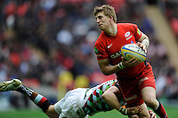 David Strettle of Saracens is tackled during the Aviva Premiership match between Saracens and Harlequins at Wembley Stadium on Saturday 31st March 2012 (Photo by Rob Munro)