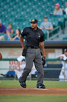 Umpire J.J. January during a Pacific Coast League game between the Oklahoma City Dodgers and New Orleans Baby Cakes on May 6, 2019 at Shrine on Airline in New Orleans, Louisiana.  New Orleans defeated Oklahoma City 4-0.  (Mike Janes/Four Seam Images)