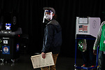 BROOKLYN, NY — OCTOBER 24, 2020:  A person wears a face mask and face shield at a voting booth inside the Barclay's Center, during the first day of early voting in the U.S. Presidential Election, on October 24, 2020 in Brooklyn, NY.  Photograph by Michael Nagle