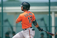 Baltimore Orioles JC Escarra (12) bats during a Minor League Spring Training game against the Pittsburgh Pirates on April 21, 2021 at Pirate City in Bradenton, Florida.  (Mike Janes/Four Seam Images)