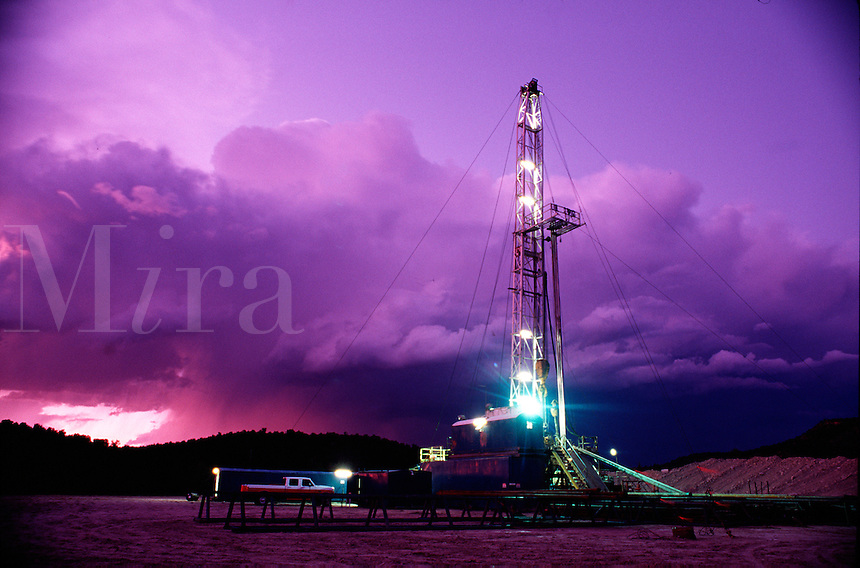 A natural gas well under stormy lavender skies.