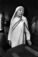 """Calcutta, India. April 04, 1975. Mother Teresa at her Kalighat Home for the Dying in Calcutta. The first Home for the Dying opened in 1952 and was a free hospice for the poor. Mother Teresa (Agnes Gonxha Boyaxihu) the Roman Catholic, Albanian nun revered as India's """"Saint of the Slums,"""" was awarded the 1979 Nobel Peace Prize."""