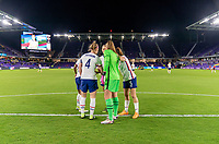 ORLANDO, FL - JANUARY 18: Becky Sauerbrunn #4, Crystal Dunn #19, Abby Dahlkemper #7, Alyssa Naeher #1 and Kelley O'Hara #5 of the USWNT huddle before a game between Colombia and USWNT at Exploria Stadium on January 18, 2021 in Orlando, Florida.