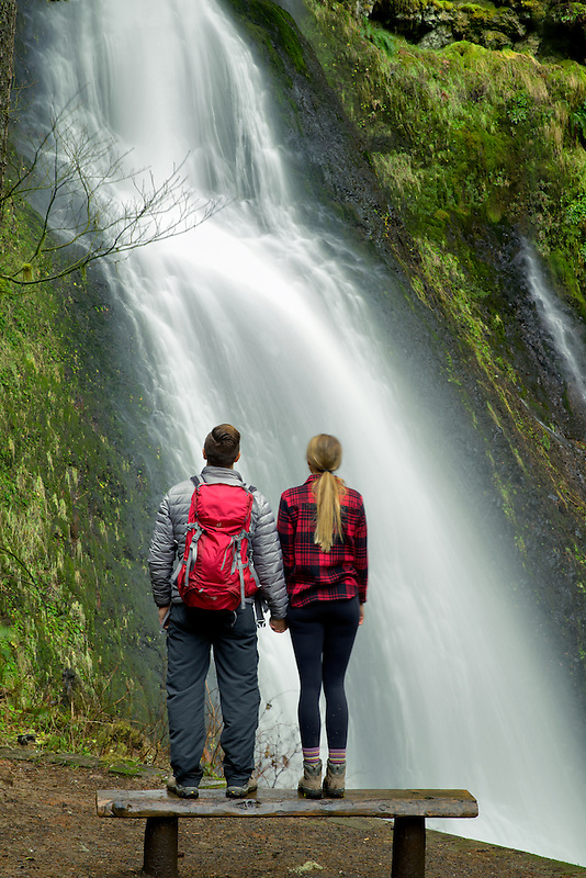 Young couple looking at Winter Falls. Silver Falls State Park, Oregon
