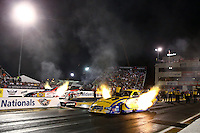 Sep 27, 2013; Madison, IL, USA; NHRA funny car driver Matt Hagan (near lane) races alongside Courtney Force during qualifying for the Midwest Nationals at Gateway Motorsports Park. Mandatory Credit: Mark J. Rebilas-