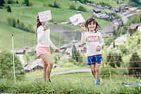 """the cutest supporters up the Col de la Colombière (HC/1618 m/11.7km@5.8%) literally cheering """"for everybody""""<br /> <br /> 73rd Critérium du Dauphiné 2021 (2.UWT)<br /> Stage 8 (Final) from La Léchère-Les-Bains to Les Gets (147km)<br /> <br /> ©kramon"""