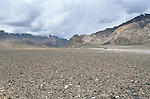 A jeep drives across the Pamir plateau on the Roof of the World in the Gorno-Badakhsahn district of Tajikistan.