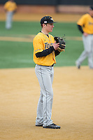Towson Tigers third baseman Chris Ruszin (15) on defense against the Wake Forest Demon Deacons at Wake Forest Baseball Park on March 1, 2015 in Winston-Salem, North Carolina.  The Demon Deacons defeated the Tigers 15-8.  (Brian Westerholt/Four Seam Images)
