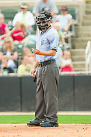 Home plate umpire Blake Felix checks his indicator during the South Atlantic League game between the West Virginia Power and the Kannapolis Intimidators at Fieldcrest Cannon Stadium on April 20, 2011 in Kannapolis, North Carolina.   Photo by Brian Westerholt / Four Seam Images