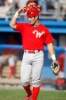 August 2, 2009:  Designated Hitter Ryan Gugel (4) of the Williamsport Crosscutters warms up the pitcher between innings during a game at Dwyer Stadium in Batavia, NY.  Williamsport is the NY-Penn League Short-Season Class-A affiliate of the Philadelphia Phillies.  Photo By Mike Janes/Four Seam Images