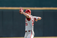 Arkansas Razorbacks pitcher Elijah Trest (20) warms up in the outfield before the game against the Tennessee Volunteers on May 14, 2021, on Robert M. Lindsay Field at Lindsey Nelson Stadium in Knoxville, Tennessee. (Danny Parker/Four Seam Images)