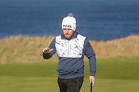 1st October 2021; Kingsbarns Golf Links, Fife, Scotland; European Tour, Alfred Dunhill Links Championship, Second round; Tyrrell Hatton of England acknowledges the applause of the crowd after holing a birdie putt on the seventh hole at Kingsbarns Golf Links