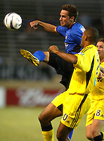 8 September 2004: Todd Dunivant of Earthquakes tries to control the ball away from Tony Sanneh of Crew at Spartan Stadium in San Jose, California.  Crew defeated Earthquakes, 1-0.  Credit: Michael Pimentel / ISI