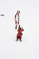 Overhead view of Lance Mackey waving goodbye & leaving on the slough in Unalakleet on Sunday evening during Iditarod 2008