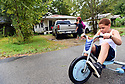 Terrell Bibbins, 10 years old, rides by his grandmother's house after school in Marksville, La., Sept. 17, 2017.