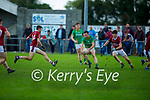 Castlegregory's Maurice Slattery in possession as Cromane's Darren Houlihan and Darragh McKeefrey bare down on him, in the Junior Football Championship Group 2 game