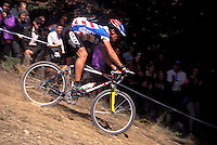 Thomas Frischknecht team Ritchey riding down the Pipeline at Grundig World Cup XC race , 1995<br /> Plymouth , Devon <br /> pic copyright Steve Behr / Stockfile