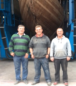 The job is on. Billy, Don and Alan Curran of Castlepoint Boatyard with Northele safely into the shed. Photo: Richard Gibson