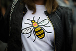 © Joel Goodman - 07973 332324 . 01/07/2017 . Manchester , UK . A woman wearing a worker bee t-shirt , the symbol of Manchester . Crowds enjoying the DJ sets ahead of the main act . Hacienda Classical play at the Castlefield Bowl as part of Sounds of the City , during the Manchester International Festival . A collaboration between DJs Mike Pickering and Graeme Park and the Manchester Camerata orchestra , Hacienda Classical reworks music by bands including the Happy Mondays and New Order and features Manchester musicians including Rowetta and Peter Hook . Photo credit : Joel Goodman