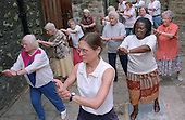 Tai Chi class for the elderly at the Third Age Project, The Crypt, West Euston, London