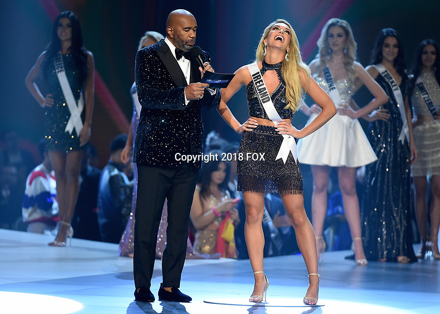 BANGKOK, THAILAND - DECEMBER 17:  Host Steve Harvey and Miss Ireland Grainne Gallanagh at the 2018 MISS UNIVERSE competition at the Impact Arena in Bangkok, Thailand on December 17, 2018. (Photo by Frank Micelotta/FOX/PictureGroup)
