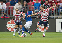 03 June 2012: US Men's National Soccer Team defender Steve Cherundolo #6 and US Men's National Soccer Team defender Clarence Goodson #21in action during an international friendly  match between the United States Men's National Soccer Team and the Canadian Men's National Soccer Team at BMO Field in Toronto..The game ended in 0-0 draw..