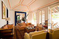 Private home in Parati Brazil. Colonial style sitting room with yellow ceiling design.