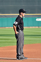 Umpire Adam Schwarz  handles the calls on third base during the Pacific Coast League game between the Salt Lake Bees and the Reno Aces at Smith's Ballpark on July 24, 2014 in Salt Lake City, Utah.  (Stephen Smith/Four Seam Images)