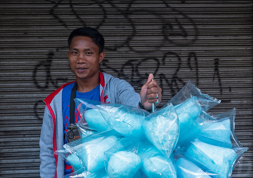 Street Photography, Manila, Philippines Selling Plastic rapped sugar Candy during Easter Good Friday,
