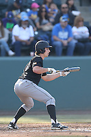 Jordan Ellis #26 of the Cal Poly Mustangs bats against the UCLA Bruins at Jackie Robinson Stadium on February 22, 2014 in Los Angeles, California. Cal Poly defeated UCLA, 8-0. (Larry Goren/Four Seam Images)