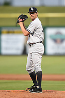 Tampa Yankees pitcher Kyle Haynes (31) gets ready to deliver a pitch during a game against the Clearwater Threshers on June 26, 2014 at Bright House Field in Clearwater, Florida.  Clearwater defeated Tampa 4-3.  (Mike Janes/Four Seam Images)