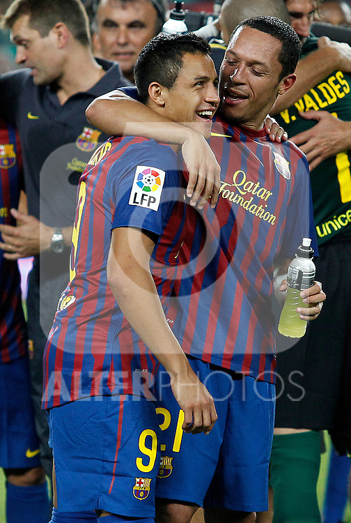 FC Barcelona's Alexis Sanchez (l) and Adriano Correia celebrates the victory during Spanish Supercup 2nd match.August 17,2011. (ALTERPHOTOS/Acero)