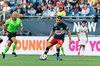 FOXBOROUGH, MA - JUNE 23: Carles Gil #22 of New England Revolution controls the ball during a game between New York Red Bulls and New England Revolution at Gillette Stadium on June 23, 2021 in Foxborough, Massachusetts.