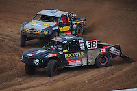 Mar. 20, 2011; Chandler, AZ, USA;  LOORRS pro two driver Brian Deegan (38) leads Greg Adler during round two at Firebird International Raceway. Mandatory Credit: Mark J. Rebilas-