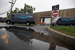 Trucks leave an Amazon.com Inc. delivery station, during the company's two-day Prime Day sale, on Tuesday, Oct. 13, 2020 in Carlstadt, NJ. Photograph by Michael Nagle